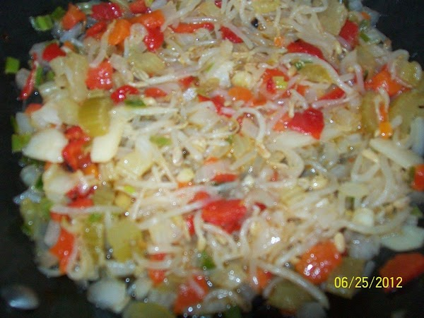 Add drained chow mein vegetables, pepper & salt and continue to cook, on low.