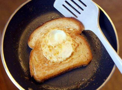 Allow egg to cook whites solid on the one side before you flip the...