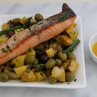 Crispy Skin Salmon with Fried Plantain and Olives Salad.