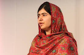 Malala Yousafzai, a young Pakistani woman, wears a colorful hijab