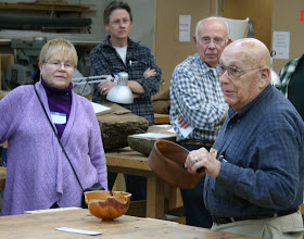 Photo: Jack Enders presents his bowl that he turned in the 70's, and is still in great shape.