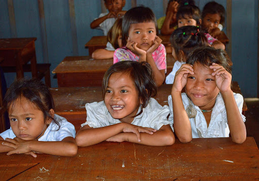 cambodia-schoolgirls3.jpg - Schoolgirls in a one-room schoolhouse outside of Phnom Penh.
