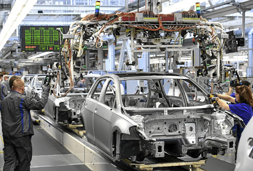 Volkswagen workers assemble VW Golf cars on a production line at the car maker's plant in Wolfsburg, Germany. Picture: REUTERS