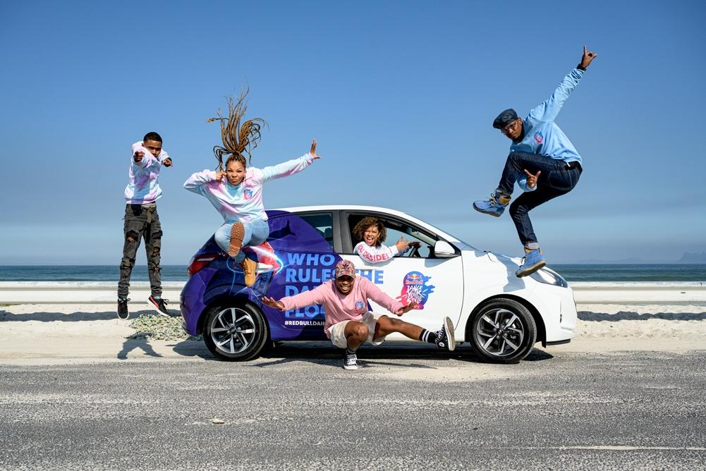 A group of people jumping in a car  Description automatically generated with low confidence