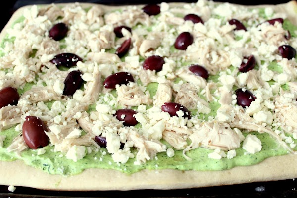 Remove the pizza dough. Spread the spinach mixture and top with olives, chicken, and...