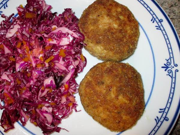Ahi Tuna Burgers, Served With Red Cabbage & Fresh Ginger Cole Slaw.