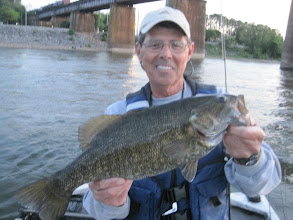 Photo: April 10, 2012 - Norman Neel with a whopper smallmouth taken fishing with guide Sam Simons.