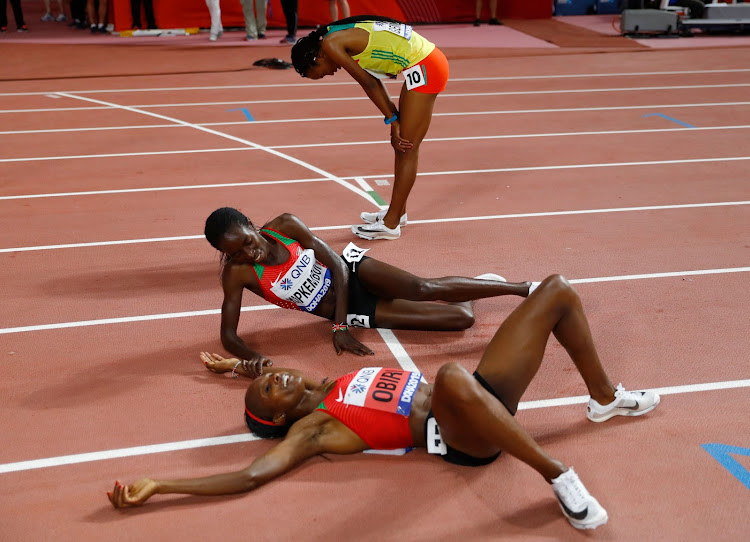 Kenya's Hellen Obiri celebrates winning gold with compatriot Margaret Chelimo Kipkemboi who wins silver in the 5,000M women race in Doha.