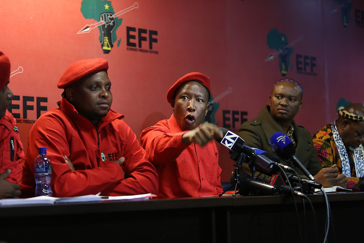 EFF leader Julius Malema and Zolani Mkhiva (CONTRALESA), brief the media in Braamfontein, Johannesburg. They spoke about Land redistribution without compensation. Also present were Floyd Shivambu (EFF) , Kgosi SetlamoragonThobejane (CONTRALESA) and various other members of the respective groups. Malema also spoke about EFF policy and announced that the party is joining forces with Contralesa. PHOTOGRAPH: ALON SKUY