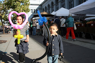 Photo: Ferry Building Marketplace, where someone gave them free balloons! A heart and a sword for two cute kids.