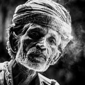 by Avanish Dureha - People Portraits of Men ( pushkar, sunset, rajasthan, dureha@gmail.com, camels, india, avanish dureha )