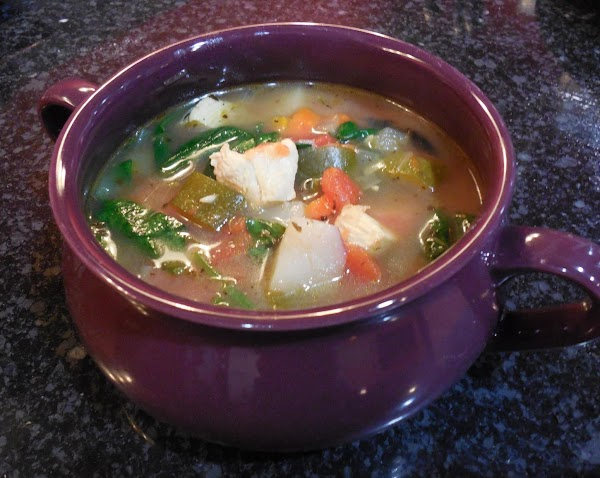Ladel soup into serving bowls. Stir in a heaping spoonful of olive tapenade and...