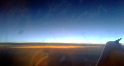 Photo: Fly-past: the lights of Madrid polluting the cloud cover. New moon dead centre.