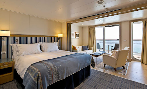 The 405-square-foot Penthouse Junior Suite on Viking Venus includes a king-size bed with luxury linens and pillows and two 42-inch flat-screen TVs.