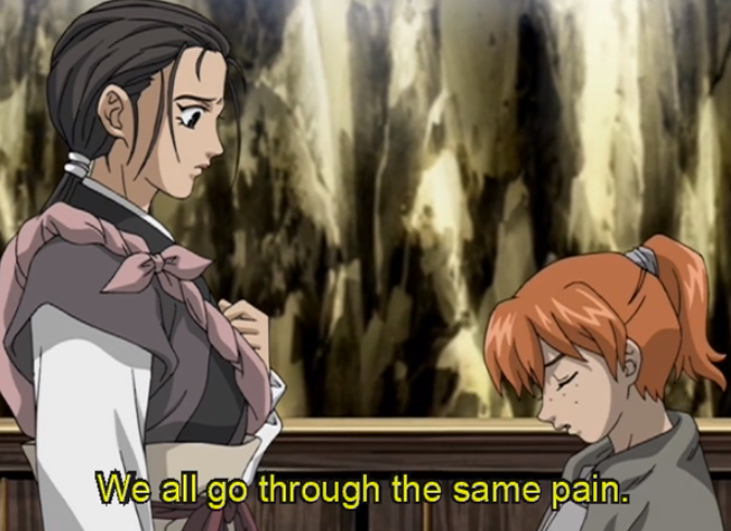 "Suzu looks at a young boy with a ponytail who says ""We all go through the same pain."""