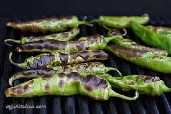 I roast the chilies on the BBQ grill, roast them til they are blistered...