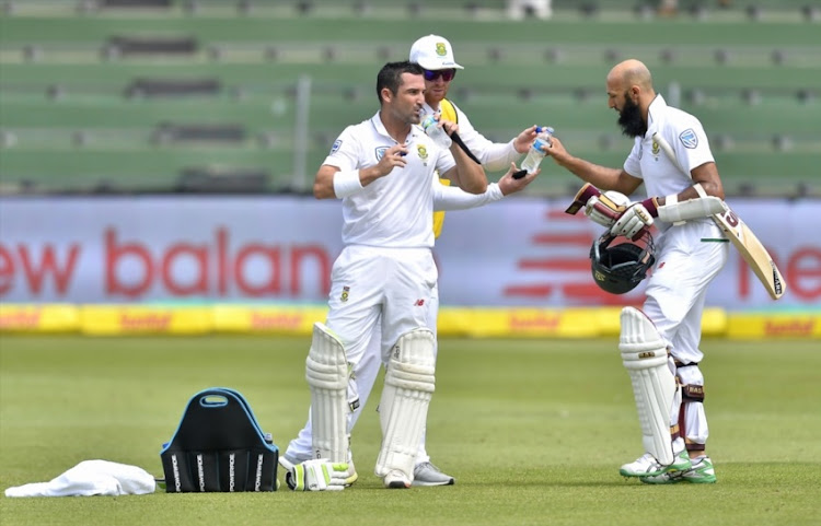 Dean Elgar of South Africa and Hashim Amla of South Africa at drinks during day 2 of the 2nd Sunfoil Test match between South Africa and Australia at St Georges Park on March 10, 2018 in Port Elizabeth.