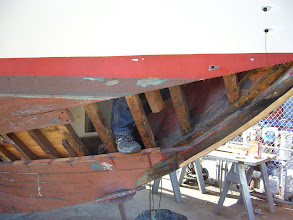 Photo: Not a view you'd ever see at sea, foot in bow; you can see the new bronze plate on the stem traversing the scarf joint and the new hanging knee above it.  That's shipwright Steve's foot but not his hanging knee.