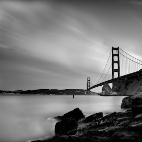 East Wind's Last Stop by Christian Wicklein - Buildings & Architecture Bridges & Suspended Structures ( water, couds, golden gate bridge, black and white, streaks, long exposure, rocks )