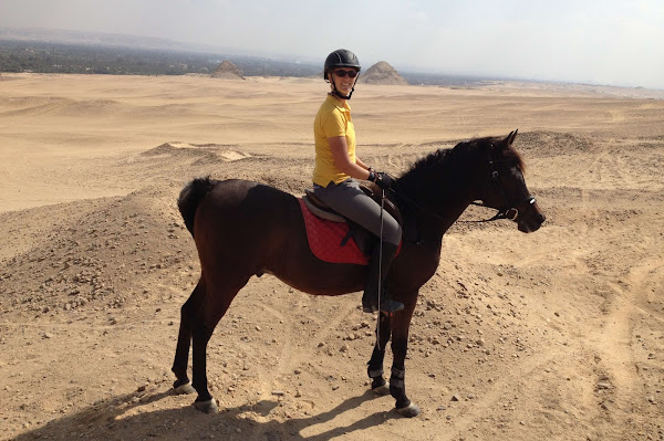 Riding horses in the desert as a horse trainer and coach during my time working abroad in egypt as a solo woman