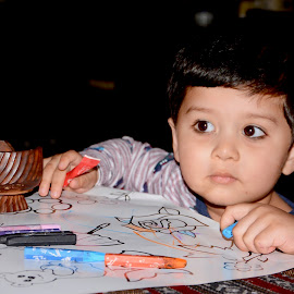 Colouring during dinner by Nadeem M Siddiqui - Babies & Children Children Candids