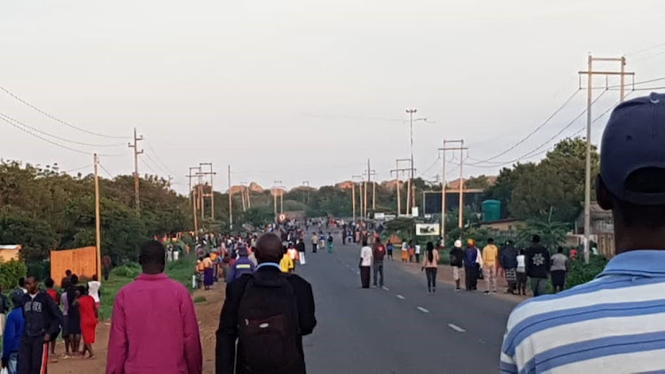 Commuters on the Harare-Bulawayo road on January 14 2019. Commuter omnibus operators stopped providing public transport as a three-day stayaway got under way.
