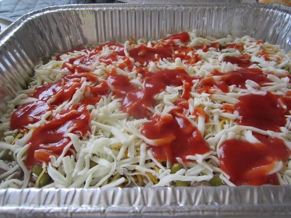 Drizzle 1/2 of tomato sauce