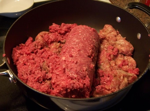 In a large skillet over medium heat, add ground beef and italian sausage (remove...
