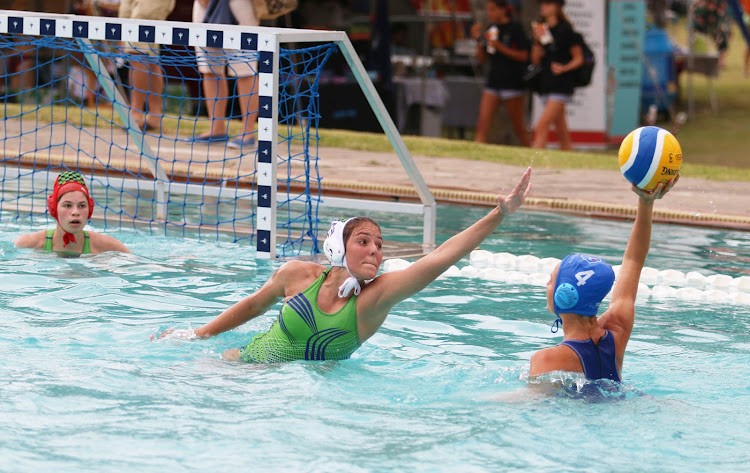 Hannah Hill of the Western Province A with ball in hand tries to shoot passed Chryssi Barroso and keeper Hannah Verries of Eden during the water polo tournament held in East London.