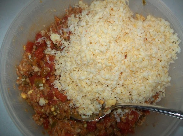 Add about 4 ounces of the shredded cheddar cheese to the meat and mix.