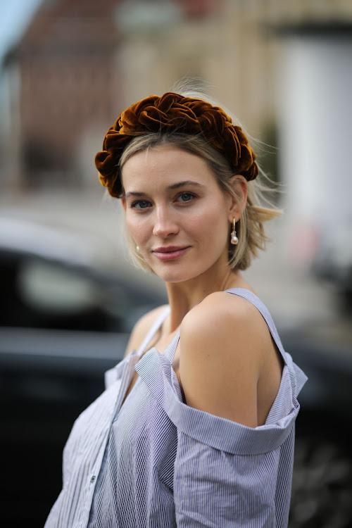 Model Mandy Bork wears a braided velvet headband.