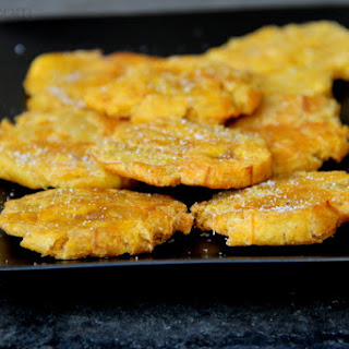 Patacones or tostones - Green plantain chips.
