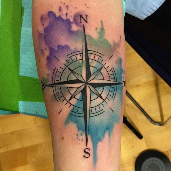Splash watercolor nautical star tattoo design on arm