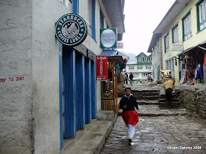 "Photo: The knock-off Starbucks in Lukla. At least it had free wi-fi.  Also notice the ""Irish pub"" with the prayer wheel."