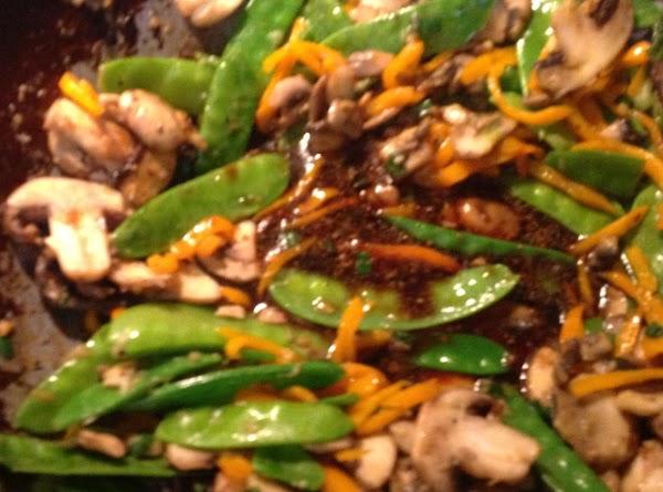 Add 1 -2 tbs of canola oil to the wok add minced garlic, minced...