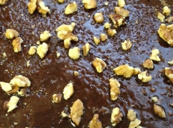 Add walnuts, if desired, to the hot glazed cake.  Cool on a baking...