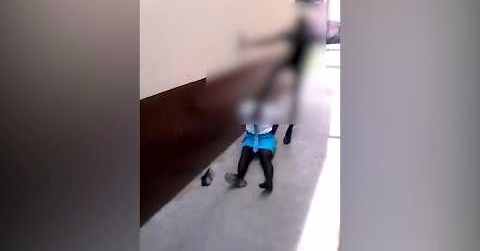 A shocking cellphone video shows a man hitting a girl dressed in school uniform.