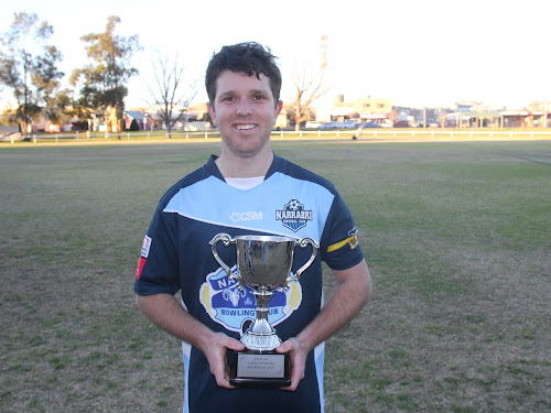 Narrabri FC captain-coach Rhys Hayne with the David Jenkins Memorial Cup, which he said was an honour to receive.