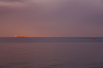 Photo: A freigher and sailboat at sunset on Lake Huron.