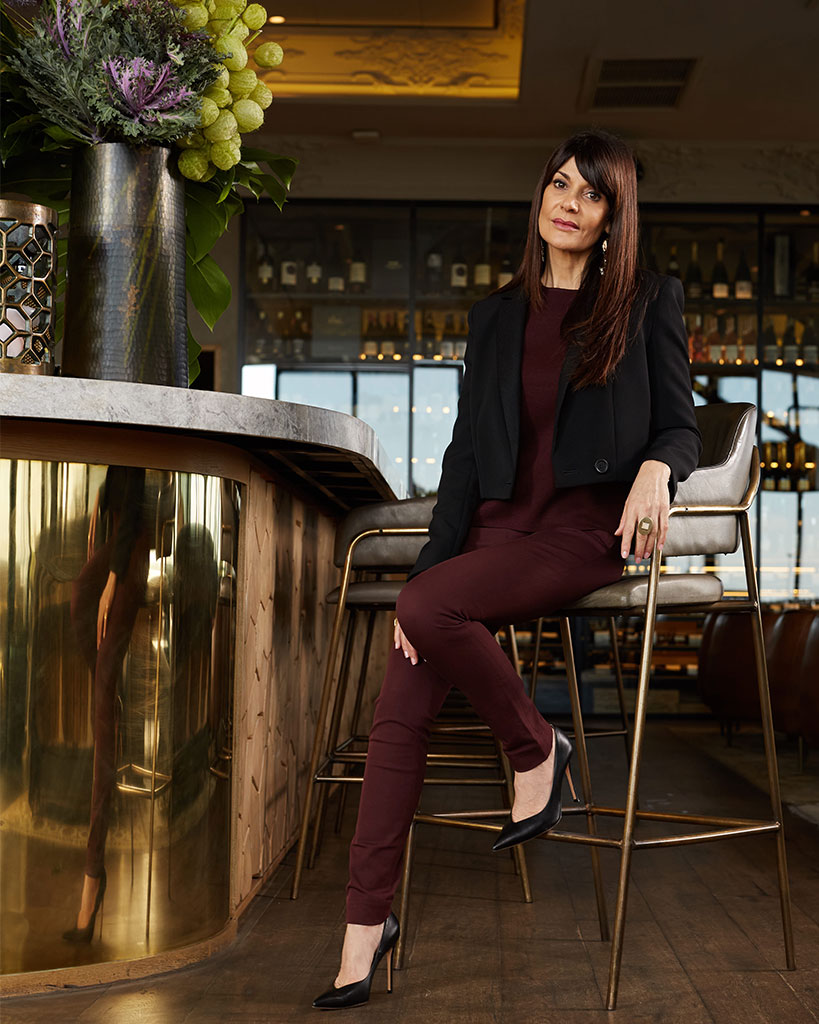 Irene Kyriacou wears: Jacket, Maje; Burgundy top and trousers, Cos; Accessories, Katy Valentine; Heels, Giuseppe Zanotti