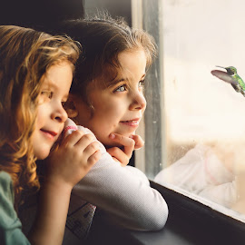 A Visitor by Jody McDonald - Babies & Children Child Portraits ( home, sisters, animals, family, hummingbird, children, childhood, birds, people )