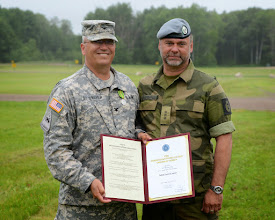 Photo: Col. Scott St. Sauver, the Camp Ripley Post Commander, was presented the Norwegian Home Guard Order of Merit from Maj. Gen. Tor Rune Raabye for his exceptional devotion and involvement to the American – Norwegian Reciprocal Troop Exchange.  The Order of Merit is the highest honor awarded by the Home Guard and was recommended by Capt. Grafsronningen (rights) for Col. St. Sauver's long lasting friendship and professionalism since they first met in 2001.
