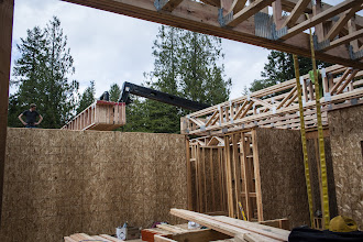 Photo: Thank goodness for a forklift.  Since most of the trusses were out in the yard, we had to bring them all in.