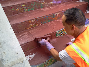 Photo: Thirteenth full day of work (Sunday, November 13, 2013): KZ Tile workers (including Ming, pictured here) continued on site through the weekend to complete grouting of the Hidden Garden Steps (16th Avenue, between Kirkham and Lawton streets in San Francisco's Inner Sunset District) 148-step ceramic-tile mosaic designed and created by project artists Aileen Barr and Colette Crutcher. For more information about this volunteer-driven community-based project supported by the San Francisco Parks Alliance, the San Francisco Department of Public Works Street Parks Program, and hundreds of individual donors, please visit our website at http://hiddengardensteps.org.