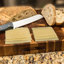 Bread and cheese by Bert Templeton - Artistic Objects Clothing & Accessories ( bread, knife, granite, swiss, havarti, cutting board, cheese )