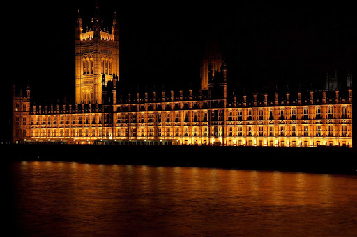 parliament-london-night.jpg - The Parliament building lit up at night on the River Thames in London.