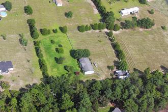 Photo: Paula's garage door is open.  Looks like her grass got cut.