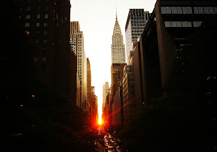 """Photo: """"Manhattanhenge...""""  This was taken during last year's Manhattanhenge sunset.The experience was rather intense. Even though I got to the overpass an hour and a half before sunset, I was told that many photographers had set up their equipment as early as 3 pm. When the sun started its very dramatic descent all that could be heard was the sound of cameras clicking away. It's definitely a phenomenon I don't plan to ever skip now that I have experienced it.  While the sun's dramatic dip only lasts for a few minutes, it's enough to take one's breath away for the entire duration. The city is bathed in the light from the sun and the most beautiful red glow is cast through the streets.  Manhattanhenge is a semiannual occurrence in which the setting sun aligns with the east–west streets of the main street grid in the borough of Manhattan in New York City. The term is derived from Stonehenge, at which the sun aligns with the stones on the solstices. It was coined in 2002 by Neil deGrasse Tyson, an astrophysicist who is the director of the Hayden Planetarium at the American Museum of Natural History.    New York Photography: Manhattanhenge sunset, Tudor City Overpass and 42nd Street    You can view this post along with information about purchasing prints of this image at my site here:  http://nythroughthelens.com/post/22589765215/manhattanhenge-overlooking-42nd-street-and-tudor  -  Tags: #photography #nyc #newyorkcity #newyorkcityphotography #sunset #manhattanhenge #manhattan #chryslerbuilding"""
