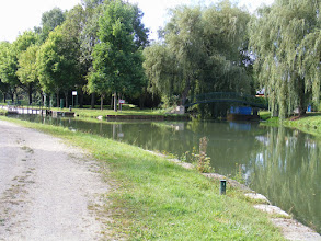 Photo: The canal splits slightly around a tiny island, to accommodate the first of several locks on the walk.