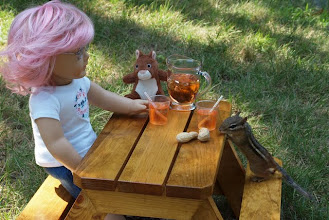 Photo: So I made some orange punch, because Veronica loves oranges (she really does!) and I brought out some peanuts, which she looked at hungrily.  Pushing giant stuffed toys across the lawn is hungry work!